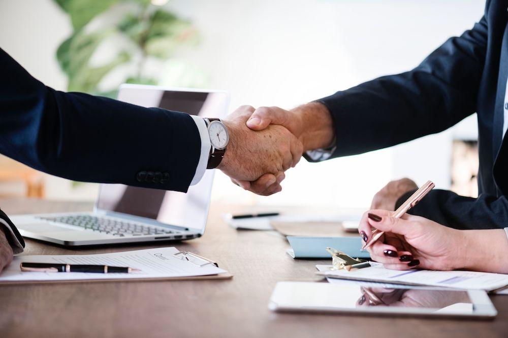 businessmen in suit handshaking